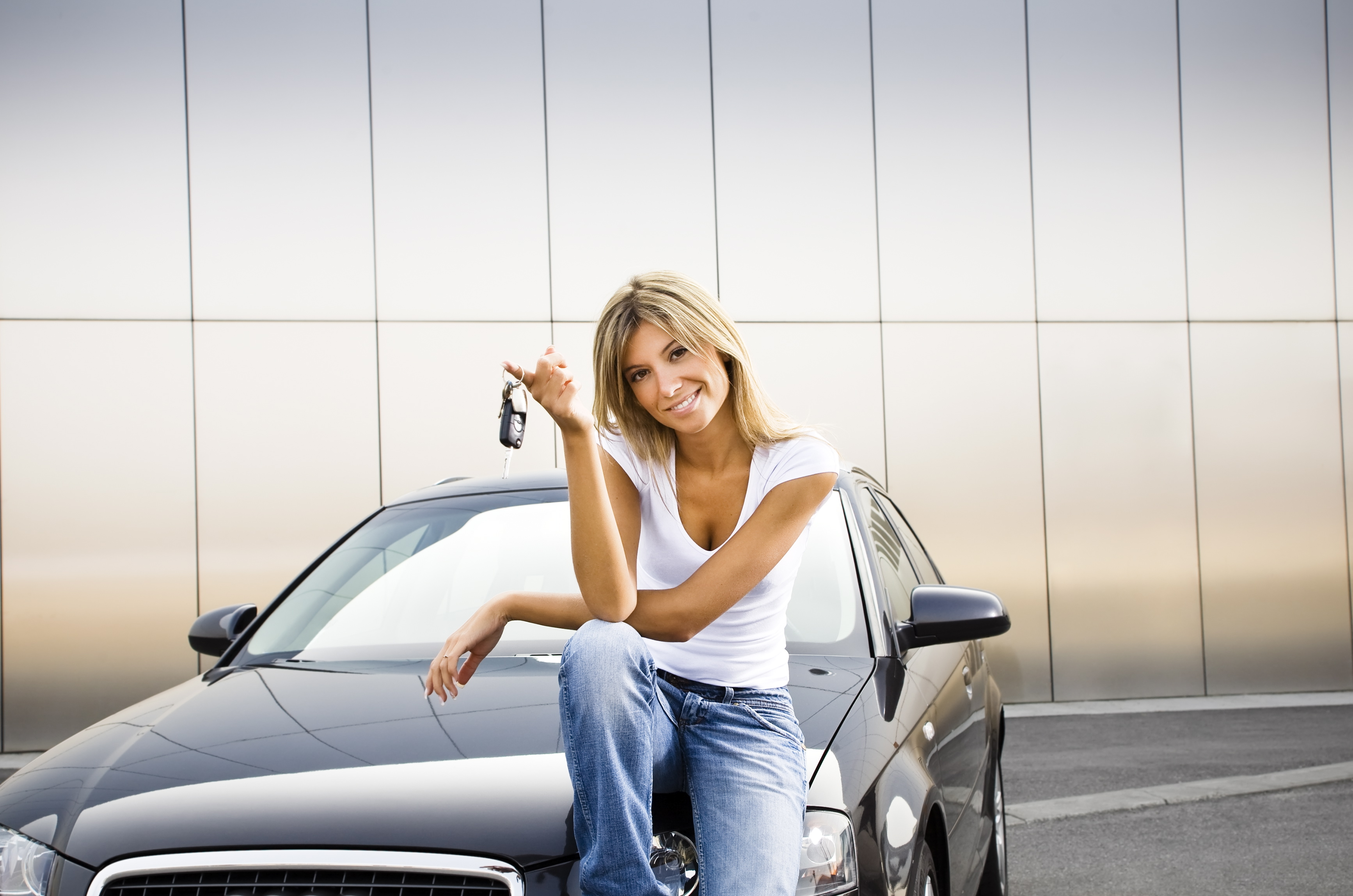 Young woman holding keys to new car   Photo Credits: I love Durban