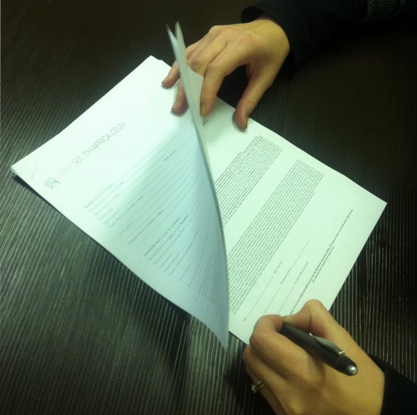 Signing the car hire excess agreement
