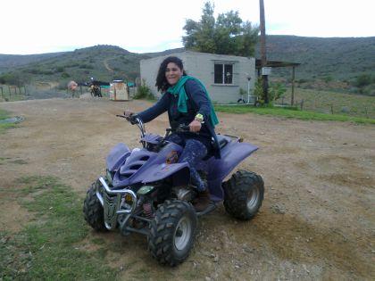 Candice on a quad bike at farm Opsoek